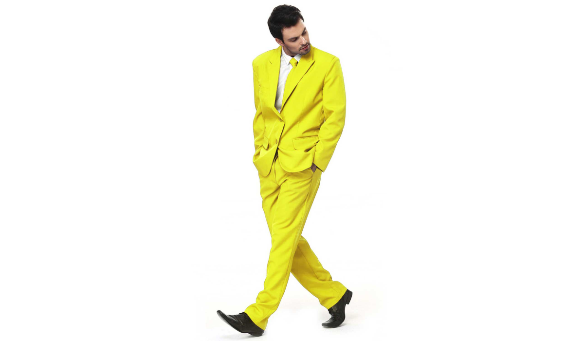 Man in yellow suit with hands in pockets