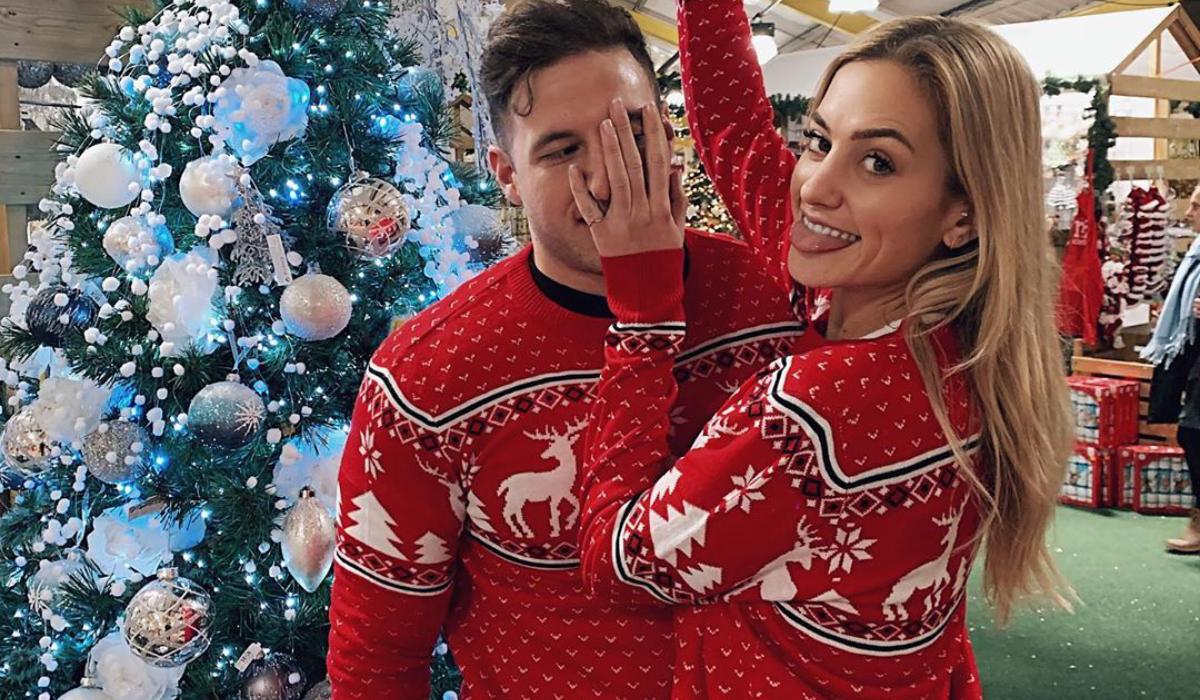 Couple wearing matching Christmas Sweaters